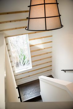 Design tip: Break up large blank spaces with a striped accent wall. The pine stripes bring in a rustic element and helps draw the eye up to the large picture window --> http://www.hgtv.com/design/hgtv-smart-home/2015/landing-pictures-from-hgtv-smart-home-2015-pictures?soc=smartpin