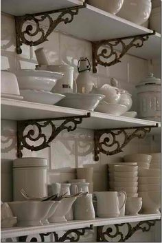 open kitchen shelving with iron brackets- perhaps add those display shelves i love over the existing cabinets?