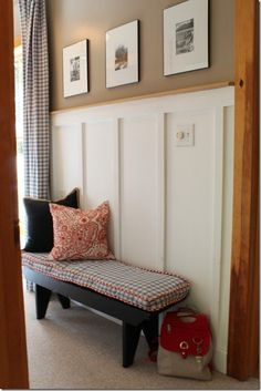 this blog shows a house with white board and batten with wood trim - living room