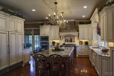 This kitchen displays all the dignity and grace of a grand room, but behind molded cabinetry doors lies a world of functionality