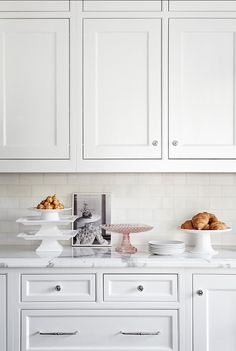 classic mix: white cabinets, subway tile, marble countertops