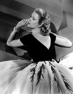 #GraceKelly in the famous white/black afternoon/cocktail dress from #RearWindow...I could watch this scene a thousand times, and still not get enough.