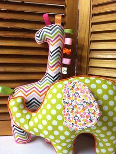 Fabric stuffed toys made especially for baby sensory stimulation. Great idea.