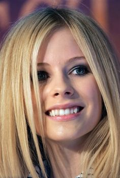 Avril..its gotta be the smile. Were generational cousins maybe that's the reason