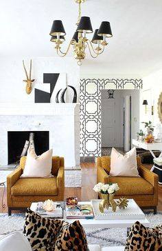 hollywood regency. living room. home decor and interior decorating ideas.   black / white / gold / camel / yes