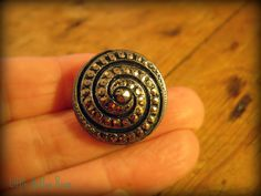 vintage black glass swirly button with silver detail at facebook.com/littlebuttonroom