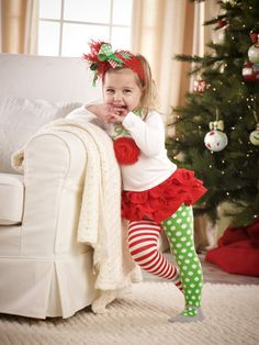 Do you think it's too early to shop for Christmas?  We don't.  This 2-piece set from Mud Pie will have your favorite little girl jumping with joy this holiday!  The girl's Ornament Skirt Set includes the white shirt and ruffled skirt. The long sleeved, white shirt features a cute ornament made from a red chiffon applique and green, ric rac trimming on the neck. The bottoms are made up of a red ruffle skirt. Fun is at its max with one red candy striped leg and one green polka-dot leg.  $38.99
