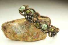 Copper Wire Woven Braided Bracelet with Beads. $95.00, via Etsy.