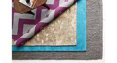 A guide to natural fiber rugs (jute, sea grass, etc.) layered area rugs