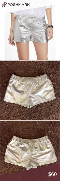 """New! EXPRESS Silver Metallic Disco Shorts Medium New with tag! Express metallic silver shorts. Size medium. Flawless! Features: thick elasticized waist band • pockets • relaxed fit through the hip & leg • dolphin style mini slits on the sides of the legs. The silver fabric is SO SPARKLY! It was difficult to pick up the shimmer with my camera. Approx 16"""" across the midpoint of the waist, lying flat, unstretched. Inseam: 2.5"""". Can be worn slightly below the natural waist, or even down on the…"""