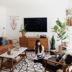 Living Room Makeover with West Elm. Great space using pieces from West Elm. Like the way the TV is camouflaged with the plants somewhat // New Darlings - Living Room. Living Room Decor Ideas Read more details by clicking on the image. Casa Retro, Retro Home, Living Room Inspiration, Home Decor Inspiration, Decor Ideas, Decorating Ideas, Furniture Inspiration, Piece A Vivre, Home And Deco