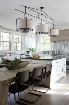 Just Pinned to Cuisines modernes: A three light drum pendant hangs over a white kitchen island topped with black quartz and a reclaimed wood dining table lined with vintage black dining chairs. Kitchen Island Dining Table, Kitchen Island Table, Rustic Kitchen, Kitchen Remodel, Modern Kitchen, Kitchen Island Design, Kitchen Island And Table Combo, Kitchen Dining Room, Kitchen Inspirations