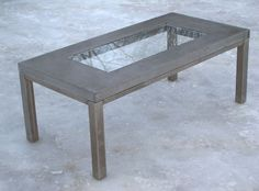 concrete, glass, and steel table