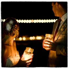 Mason jars as candle holders... new year's, wedding, engagement party. etc..
