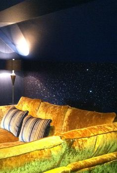 glitter accent wall ~ I just had the most awesome idea- to use a dark paint with glitter for the movie room. That way it will look even more like a night sky. Could also do this treatment on the ceiling.
