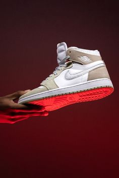 """Perfect for fall, or any other season. The Women's Air Jordan 1 Zoom Comfort """"Olive Aura"""" combines several materials in wearable earth tones for unlimited style range. Did we mention the shoe features a cloud-like Zoom Air cushioned sole, too?"""