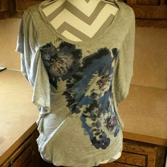 Floral Grey Fashion Shirt Sleeve Grey with flowers on the front. Plain back. Draped, ruffle sleeves. Lauren Conrad Tops Tees - Short Sleeve