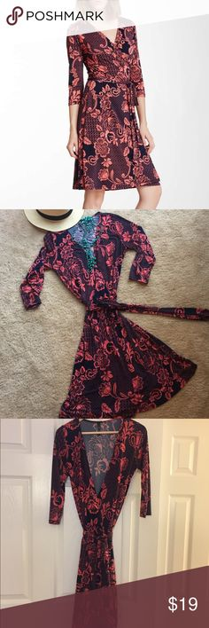 Adorable! Printed wrap dress Paisley printed wrap dress. Not a faux wrap...an actual wrap dress (see pictures)! Super soft material, drapes nicely, flattering and the wrap portion stays put. Can wear practically year round...with flats, heels, or sandals in the spring/summer or with boots and a blazer in the fall and early winter. LOVE this dress, but it no longer fits. Originally purchased from Haute Look/Nordstrom Rack. In excellent condition. Machine washable and hang up to air dry…
