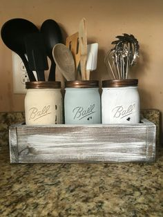 ***you can add a personalized stencil, handles, or change up the stain of the box for a small additional fee Add a hand painted stencil for $2.00!!! This utensils holder is the perfect addition to your rustic country kitchen decor. It is functional and beautiful. This is a rustic planter with three painted mason jars to hold your utensils. The mason jars have been painted distressed and sealed. The planter box is sanded, stained and sealed. This set includes: 3 Painted Quart Ball Mason ...