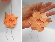 origami - colgante realizado con una flor plegada en papel