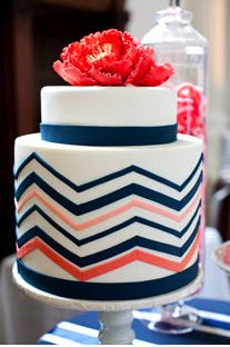 Coral and navy chevron cake