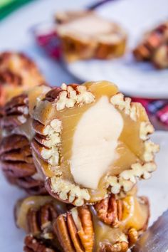 The sweetest vanilla nougat, wrapped up in soft buttery caramel, with a layer of pecans on the outside to make a perfect candy log. This is Christmas at it's finest! Perfect for host or neighbor gifts. From The Food Charlatan.
