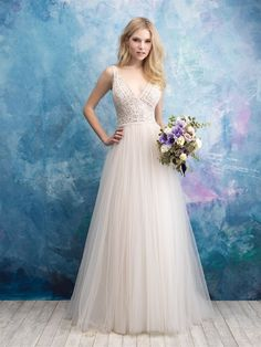 Allure Bridals 9552   Geometric beadwork pairs with the lovely tulle of this A-line gown.