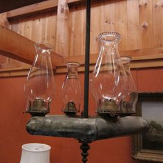 homemade oil lamps above the dinner table - Sue and Charlie's house
