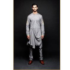 Don't want to try something too out-of-the-box? Maybe you should indulge in the drape kurta.   11 Brilliant Outfits Every Man Needs To See Before Shaadi Season