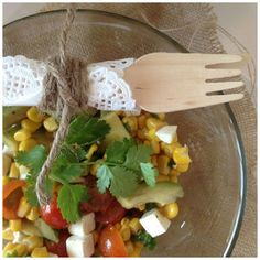 Warm corn, avocado, feta cheese, cherry tomatoes , cilantro, olive oil and lime juice. Easy and fresh