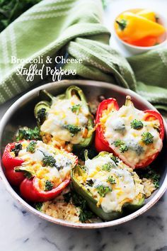 Broccoli and Cheese Stuffed Peppers - A delicious mixture of broccoli, cheese and rice stuffed inside colorful bell peppers. These amazing stuffed peppers have all the comfort and flavor you want, with the bonus of veggies and cheese!