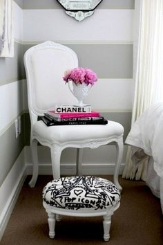 between the #striped wall and the #white #chair ...and of course the #CHANEL book yup loving everything about this!
