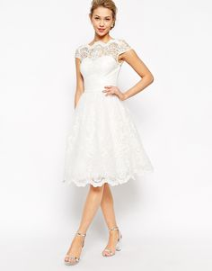 Modest white lace midi dress with cap sleeves available at Mode-sty