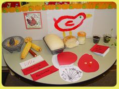 """Set up a Discovery Table with items from """"The Little Red Hen"""". This version is by Paul Gauldone. Bake bread from a frozen loaf, grind corn in a matate, Plant winter rye seeds, write Key Words and illustrate a Shape Book."""