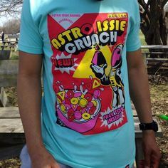 """Men's 1980s Spaceman Crunch Cereal Unisex T-shirt This Favor cereal t-shirt is """"tropical punch"""" and looks great with your favorite pair of sneakers. If you remember the cereal from the 80s, well this tee will evoke nostalgia in you. limited quantities left Astro Issie Tops Tees - Short Sleeve"""