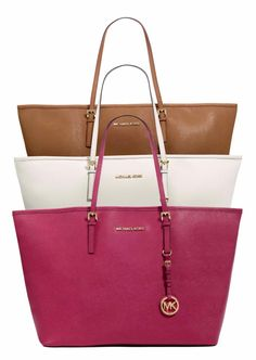 Michael Kors Jet Set Travel Tote. The pink one WILL be my summer bag!