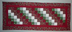 http://quiltedwithtlc.com/images/gallery/table_runners/tablerunner12.jpg