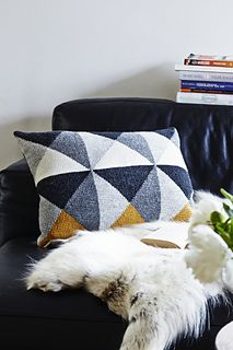 The grey tones in this cushion render a beautiful graphical effect. If you want to change the colours then try just changing the yellow colour.