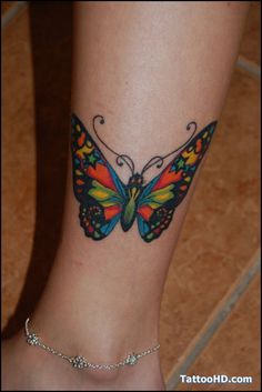 Lower leg butterfly. https://www.facebook.com/pages/Unique-Tattoo-Designs/360503994027522