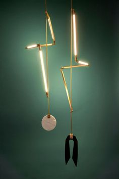 Stunning mobile-like lighting from New York based designer Bec Brittain. Helix is made from custom brass hardware and LED tubes wrapped around a central support and exists both as a pendant and floor version. Read more: Bec Brittain