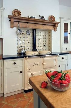 Aga with shelf over. Corbel support brackets are used to make a shelf for saucepans. You can find similar brackets at www.buycarvings.co.uk Aga Stove, Kitchen Stove, Kitchen Mantle, Stove Oven, Solid Wood Shelves, Wood Shelf, English Cottage Kitchens, Country Kitchens, Home Kitchens