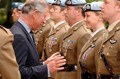 What must Prince Charles have thought as he made his way down the line, pinning medals