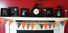 The beginning of my Halloween mantel this year my daughters all dressed as witches, need to get my granddaughters too!
