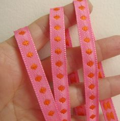 3 yards Orange on Hot Pink POLKA DOT Twill Tape Jacquard trim. 7/16 inch wide. 934-05. $4.45, via Etsy.