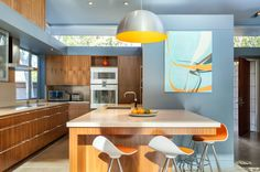 The kitchen is part of the new section in the center of the house and features clerestory windows that let natural light flood into the space.