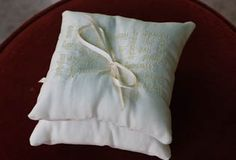 Wedding - ring-bearer pillows embroidered with bride & groom descriptions of each other.