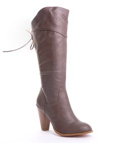 These beautiful boots will give a style boost to the next night out. A sleek silhouette, towering heel and dainty bow tie on the back make them a modern maven's must-have. 4'' heel13'' shaft13.5'' circumferenceSide zipper closureMan-made