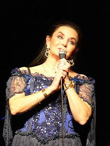 Crystal Gayle (born Brenda Gail Webb on January 9, 1951in Paintsville, Kentucky) Loretta Lynn's youngest sister. Country Singer best known for a series of country-pop crossover hits in the late 1970s and 1980s.