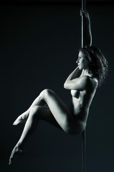 Professional nude pole dancers firmly