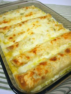 easy Chicken Enchiladas (S)  Amy Brush Seeley   2 big cans of chicken  half of a taco seasoning packet  1/4 cup of chicken broth  Heat and spread it in 7 Mission low carb tortillas and rolled up in casserole.  Warm an 8oz  cream cheese, 1 cup of sour cream,  1 tsp garlic powder, 1 tsp onion powder, sea salt and a sprinkling of chili powder. Blend & pour over the enchiladas, cover and bake for 25 mins at 350*